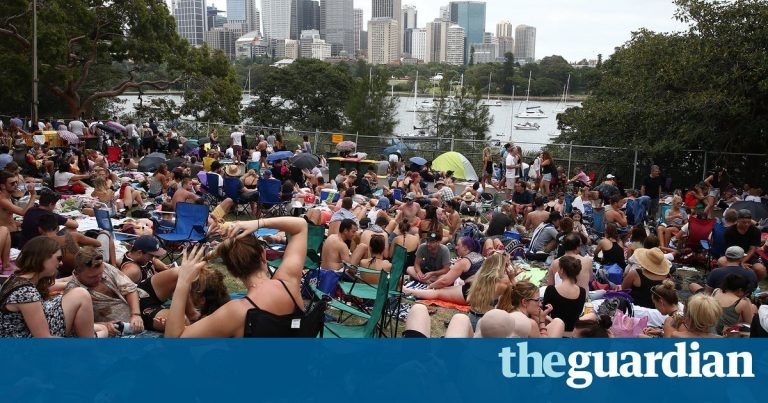 Sitting room only: New Year's Eve crowds descend on Sydney harbour to nab best view of the fireworks