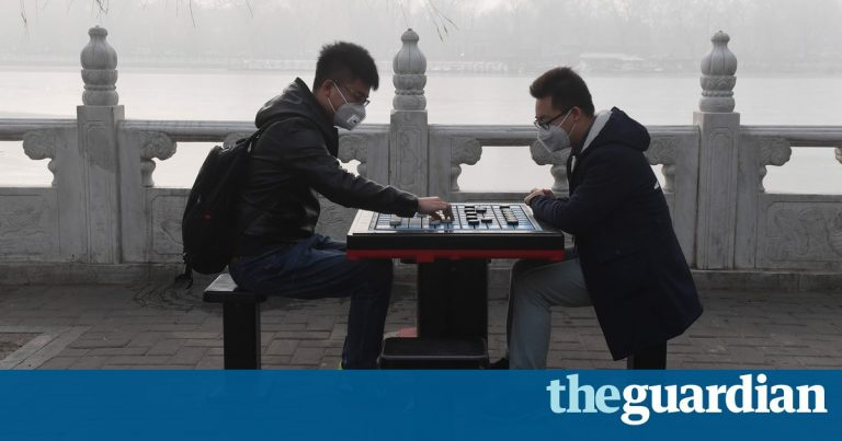 China smog: millions start new year shrouded by health alerts and travel chaos